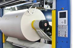 Paper rolls in a printing machine of a large print shop. Print of newspaper stock photos