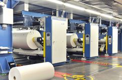 Paper rolls in a printing machine of a large print shop. Printing newspapers royalty free stock image