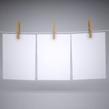 Paper on a rope with clothespins. Render on a gray background Stock Photo