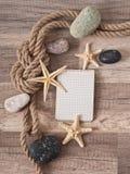 Paper, rope, starfish, sea stones Stock Photo