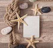Paper, rope, starfish, sea stones Stock Photography