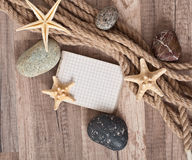 Paper, rope, starfish, sea stones Royalty Free Stock Images