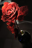 Paper rose. Artificial rose made from paper and plastic on the dark background royalty free stock photography