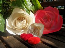 Paper rose and crochet red hearts Stock Images