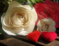 Paper rose and crochet red hearts Royalty Free Stock Photos