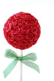 Paper Rose Topiary. Vertical photo of red paper rose topiary with green ribbon Stock Image