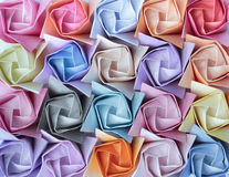 Paper roses. Top view of twenty colourful paper roses arranged as a decorative background royalty free stock photos