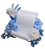Paper and roses. Paper for the letter is held by a glass hand and Stock Photography