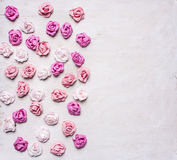 Paper roses of different colors stacked  white wooden background, valentines day Royalty Free Stock Image