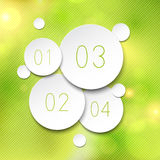 Paper round bubbles over green. Royalty Free Stock Images