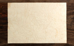 Paper rumpled old blank weathered  wood. Background Stock Photography