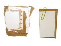 Paper scraps and paperclip isolated Stock Images