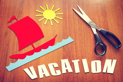 Paper scraps about Vacation on the table Stock Image