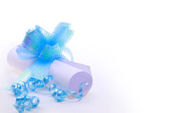 Paper Scroll And Blue Bow Stock Photo