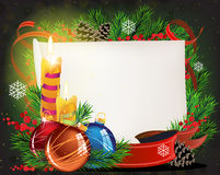 Paper scroll with  candles and Christmas balls Royalty Free Stock Photo