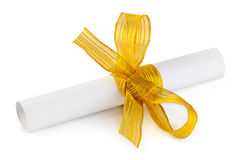 Paper scroll and gold bow Stock Photography