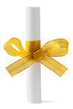 Paper scroll and gold bow Stock Photo