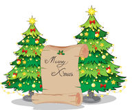 A paper scroll in the middle of the christmas trees Stock Image