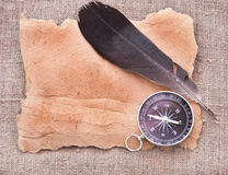 Paper scroll , quill pen and compass Royalty Free Stock Photo