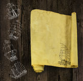 Paper scroll with sailing ships silhouettes Stock Images