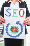 Seo concept shown by a businesswoman royalty free stock images