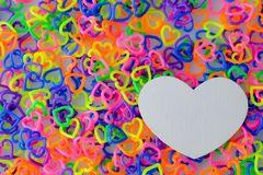 Paper shape heart on colorful mini heart toy. Plastic stock photos