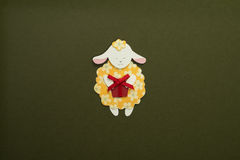 Paper sheep applique on texture background. Cute handmade sheep holding gift box Royalty Free Stock Image