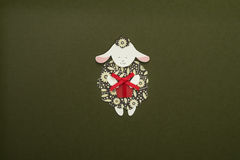 Paper sheep applique on texture background. Cute handmade sheep holding gift box Royalty Free Stock Photography