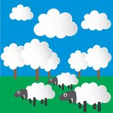 Paper sheep, grazing in the meadow. Royalty Free Stock Images