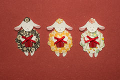 Paper sheeps applique on texture background. Cute handmade sheeps holding gift box Stock Image