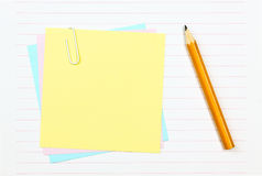 Paper sheet. Some colored paper sheet an a pencil Royalty Free Stock Photography