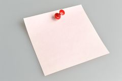 Paper sheet attached with office button on gray Royalty Free Stock Images