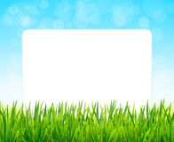 Paper sheet on background with green grass  and blue sky Royalty Free Stock Photos