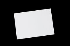 Paper sheet. On a black background Royalty Free Stock Photo