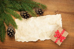 Paper Sheet, Christmas tree branches and gift Royalty Free Stock Images