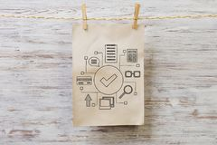 Paper sheet on clip. Mixed media Stock Photography