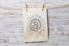 Paper sheet on clip. Mixed media Stock Images