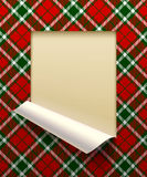 Paper sheet cut framed and partially rolled up with tartan backg Royalty Free Stock Photos