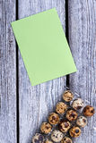 Paper sheet and eggs. Royalty Free Stock Photos