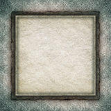 Paper sheet in golden frame on grunge background Royalty Free Stock Photo