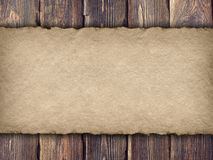 Paper sheet on old planks Stock Image