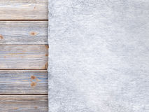 Paper sheet on old wood plank wall background Royalty Free Stock Image