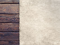 Paper sheet on old wood plank wall background Stock Images