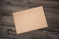 Paper sheet on old wooden background Royalty Free Stock Photography