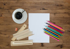 Paper sheet painting supplies and cup of coffee Stock Photo