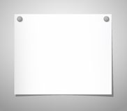 Paper sheet with pushpins on gray Royalty Free Stock Photos