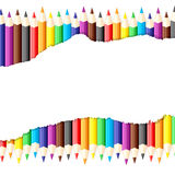 Paper sheet with ragged edge on background of colored pencils Royalty Free Stock Photography
