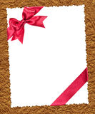 Paper sheet with red bow on golden Royalty Free Stock Photos