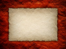 Paper sheet on red rough wall. Background Stock Images