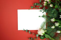 Paper sheet and rose. stock photos